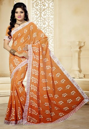 Diffusion Captivating Peach Puff Embroidered Saree