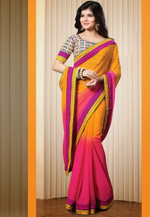 Diffusion Gleaming Orange And Pink Embroidered Saree