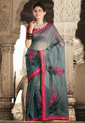Diffusion Melodic Gold Color And Red Embroidered Saree